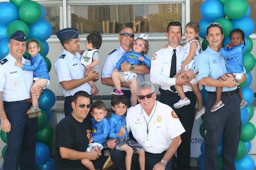 1st responders and servicemen with their Skilled children
